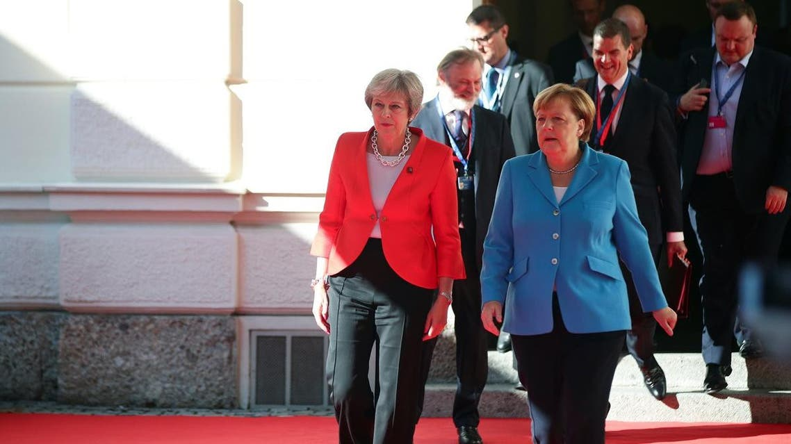 German Chancellor Angela Merkel and Britain's Prime Minister Theresa May arrive for the informal meeting of European Union leaders in Salzburg, Austria, on September 20, 2018. (Reuters)