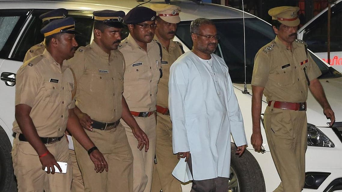 Bishop Franco Mulakkal (2nd R), accused of raping a nun, is escorted by police outside a crime branch office on the outskirts of Kochi in the southern state of Kerala, India, on September 21, 2018. (Reuters)