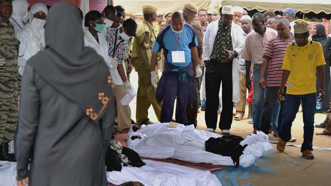 People identify victims of a ferry accident at Maisara grounds in Stone Town, Zanzibar, Tanzania, on Thursday July 19, 2012. (AP)