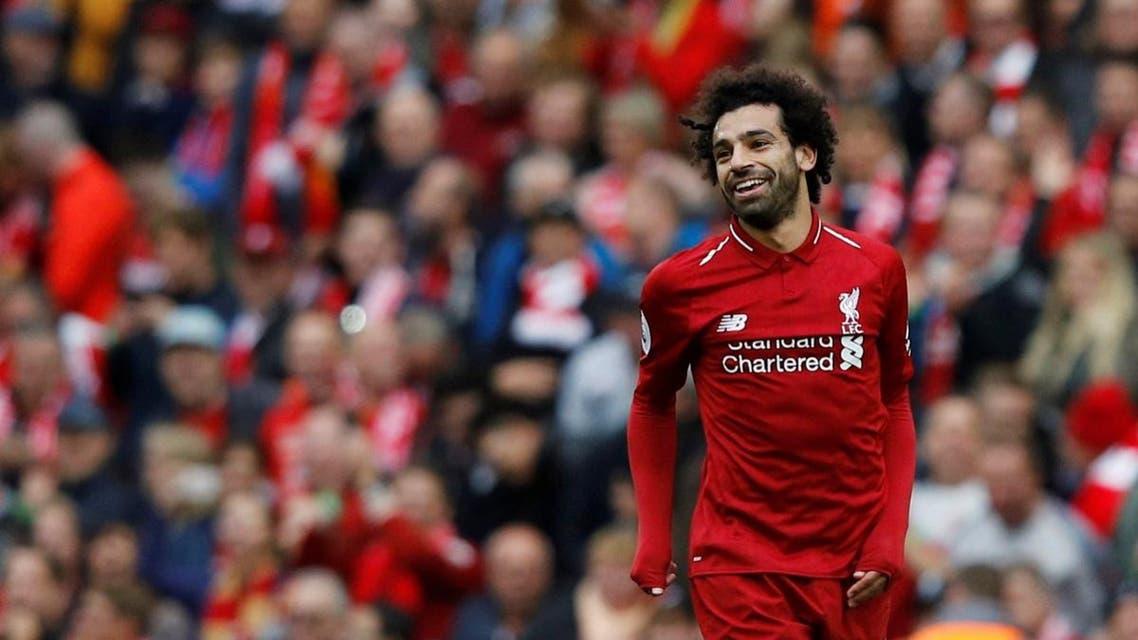 Liverpool's Mohamed Salah celebrates scoring their third goal. (Reuters)