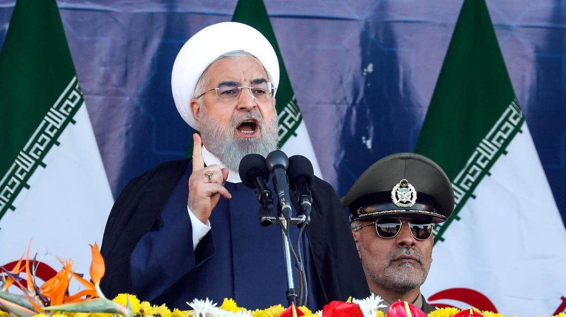 Iranian President Hassan Rouhani delivers a speech during the annual military parade in Tehran on Saturday. (AFP)