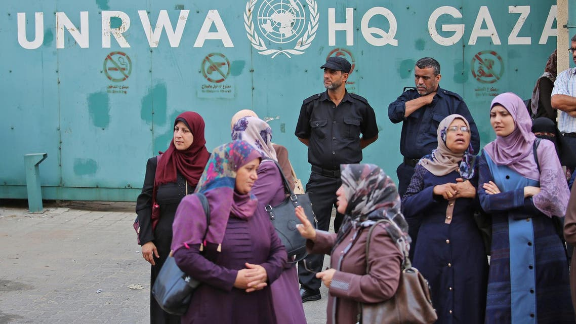 Palestinian employees of UNRWA take part in a protest against job cuts by UNRWA, in Gaza, on September 19, 2018. (AFP)
