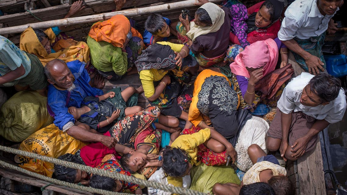 Rohingya refugees arriving by boat at Shah Parir Dwip on the Bangladesh side of the Naf River after fleeing violence in Myanmar on September 12, 2017. (AFP)