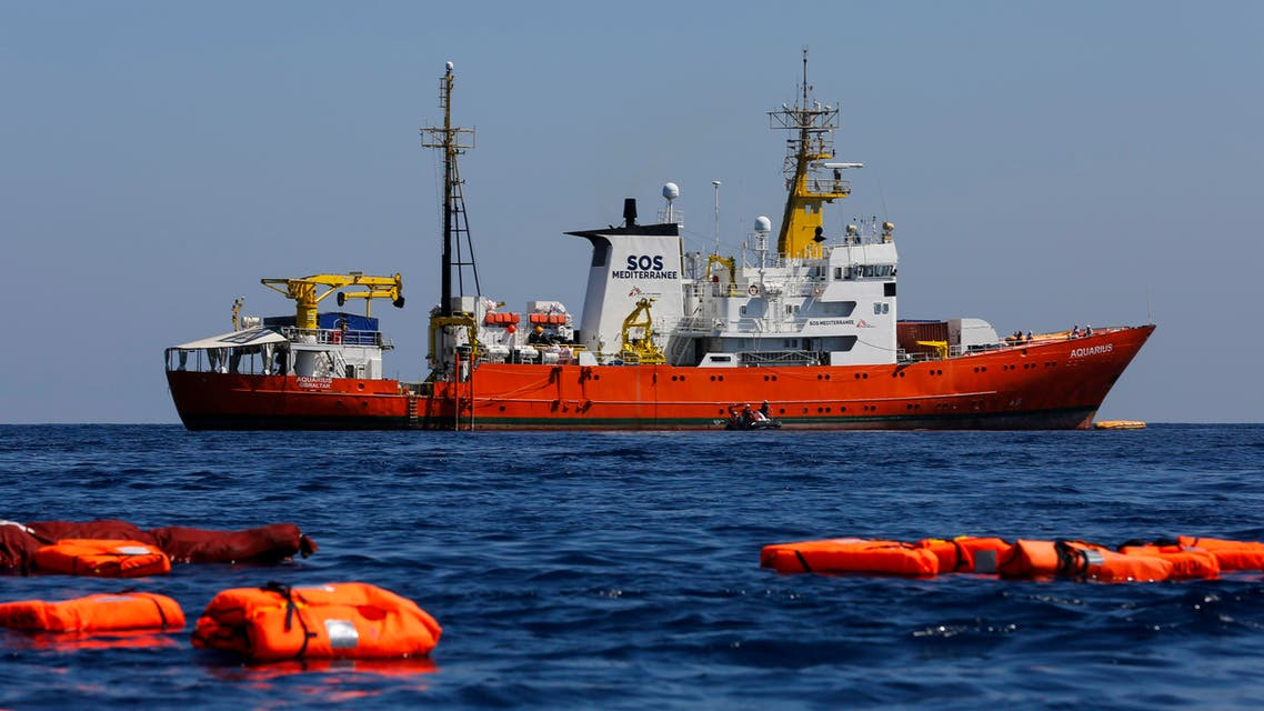 """(FILES) This file photo taken on June 23, 2018 between Lampedusa and Tunisia shows Aquarius rescue vessel, chartered by French NGO SOS-Mediterranee and Doctors Without Borders (MSF), during a rescue drill at open sea. France said on September24, 2018, that it will seek a """"European solution"""" to another brewing standoff over the Aquarius migrant rescue ship, saying the vessel should head instead to """"the nearest safe port"""". The announcement from the prime minister's office to AFP came shortly after SOS Mediterranee, the charity which operates the boat, said it was heading from the Libyan coast towards the southern French port with 58 migrants onboard."""