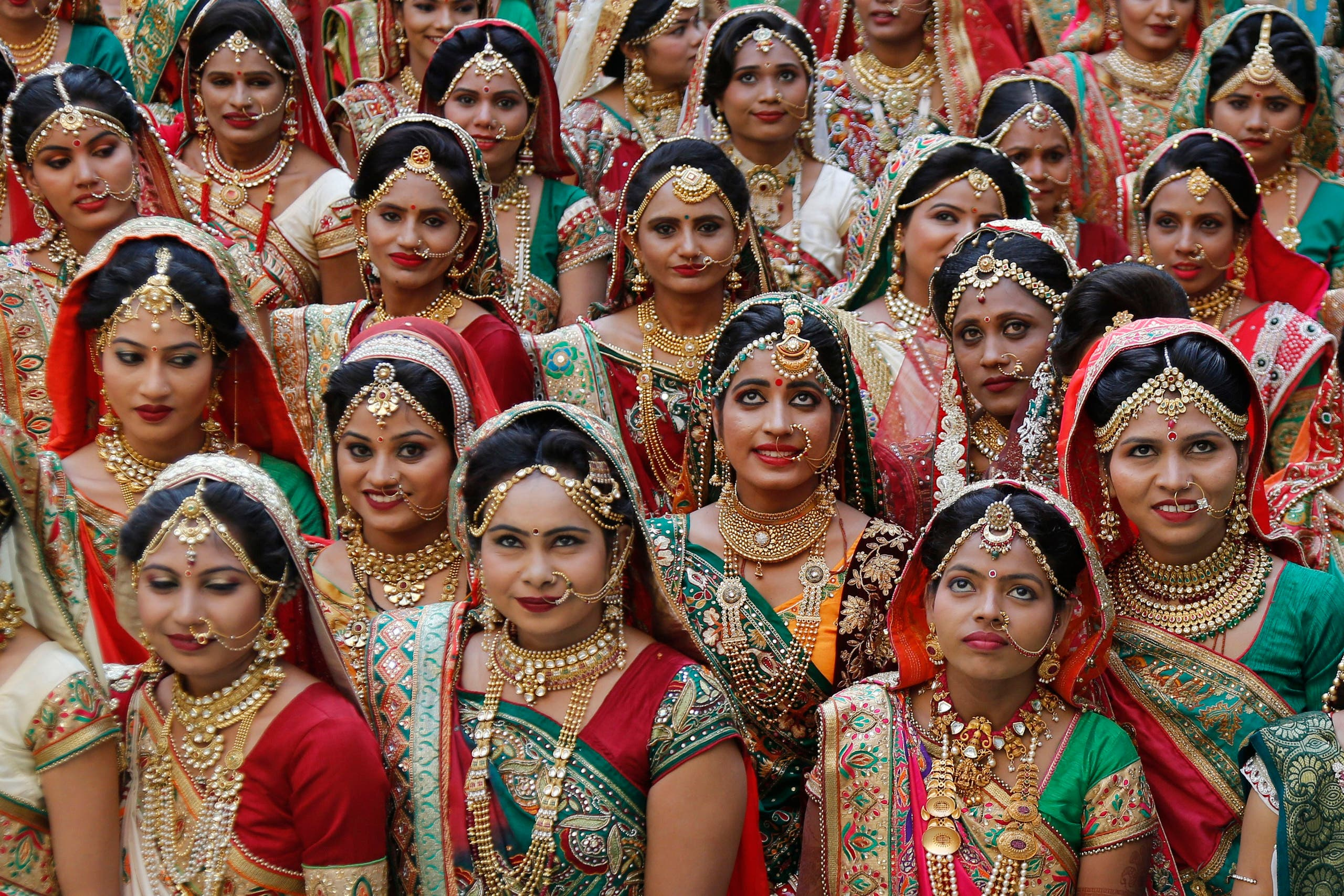 Indian brides pose for photograph before a mass wedding in Surat on Dec. 24, 2017. (File photo: AP)