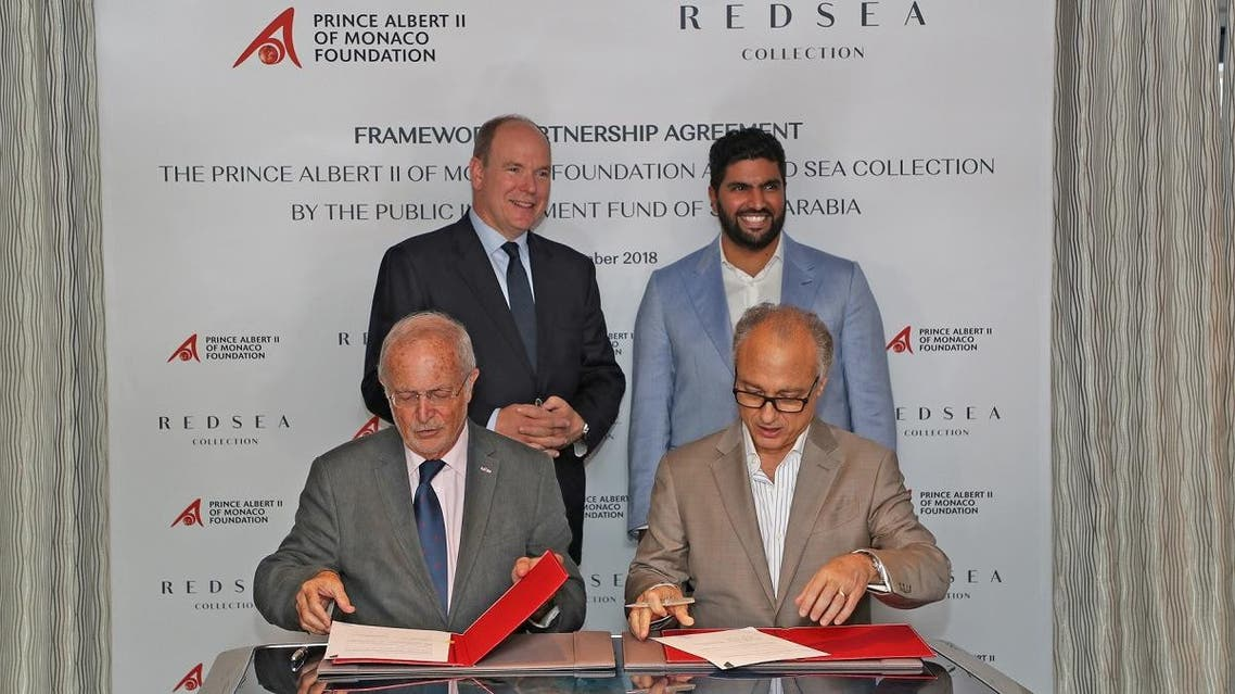 Prince Albert II of Monaco (left), Prince Badr bin Abdullah Al Saud, the Saudi Minister of Culture (right) attending the signing ceremony by Bernard Fautrier – Vice President and CEO of the Prince Albert II of Monaco Foundation, and Nicholas Naples (CEO Amaala - The Public Investment Fund).