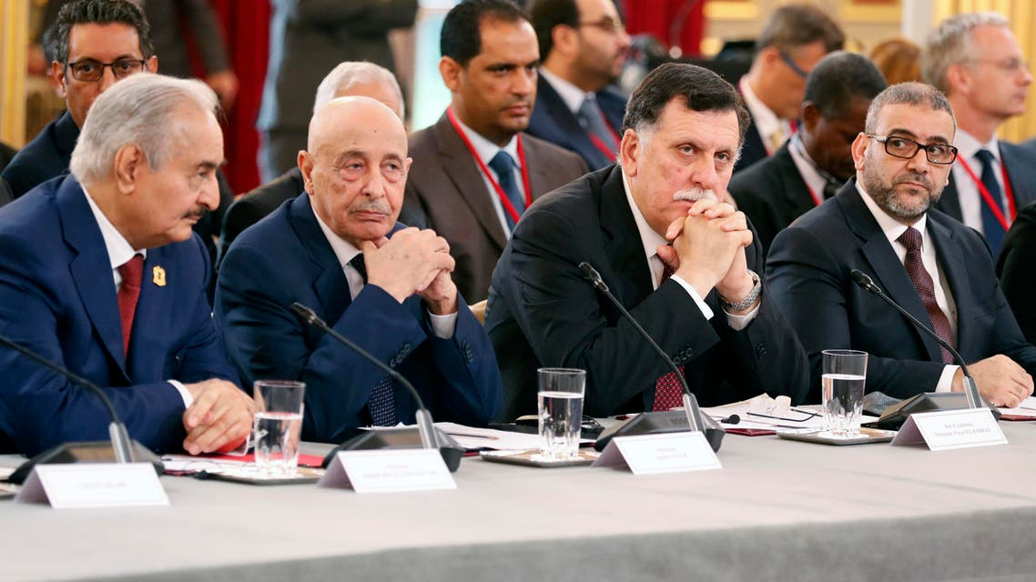 (From L) Libyan National Army's Field Marshal Khalifa Haftar, Libya's parliament speaker based in the eastern town of Tobruk Aguila Saleh Issa, Libya's Presidential Council of the Government of National Accord Fayez al-Sarraj, and President of the High Council of State of Libya Khaled Mechri attend an International Congress on Libya at the Elysee Palace in Paris, on May 29, 2018. Rival Libyan leaders vying for influence in the fractured and war-scarred country meet in Paris for a major peace conference seen as a risky French-backed push for a political settlement in the country.