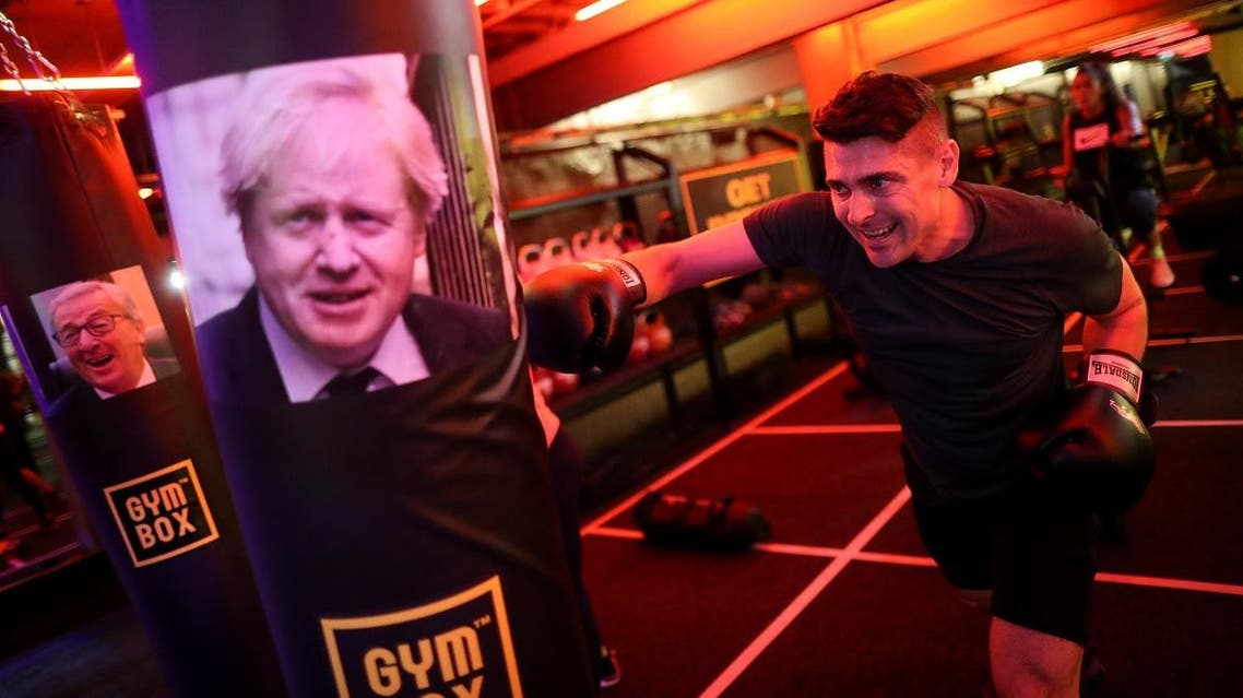 A gym member punches a boxing bag containing an image of Britain's former Foreign Secretary Boris Johnson. (Reuters)