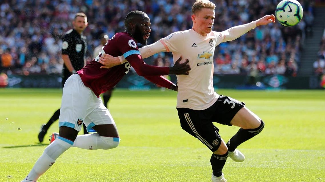 Manchester United's Scott McTominay in action with West Ham's Arthur Masuaku.  (Reuters)