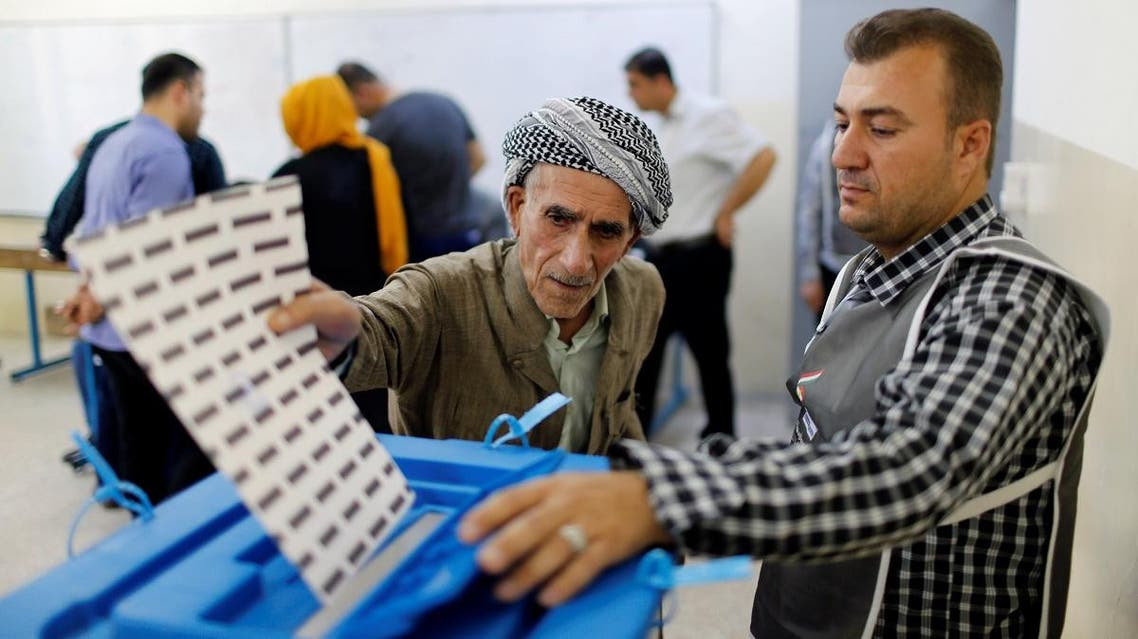 An elderly Kurdish man casts his vote at a polling station, during parliamentary elections in the semi-autonomous region in Erbil, Iraq, on September 30, 2018. (Reuters)