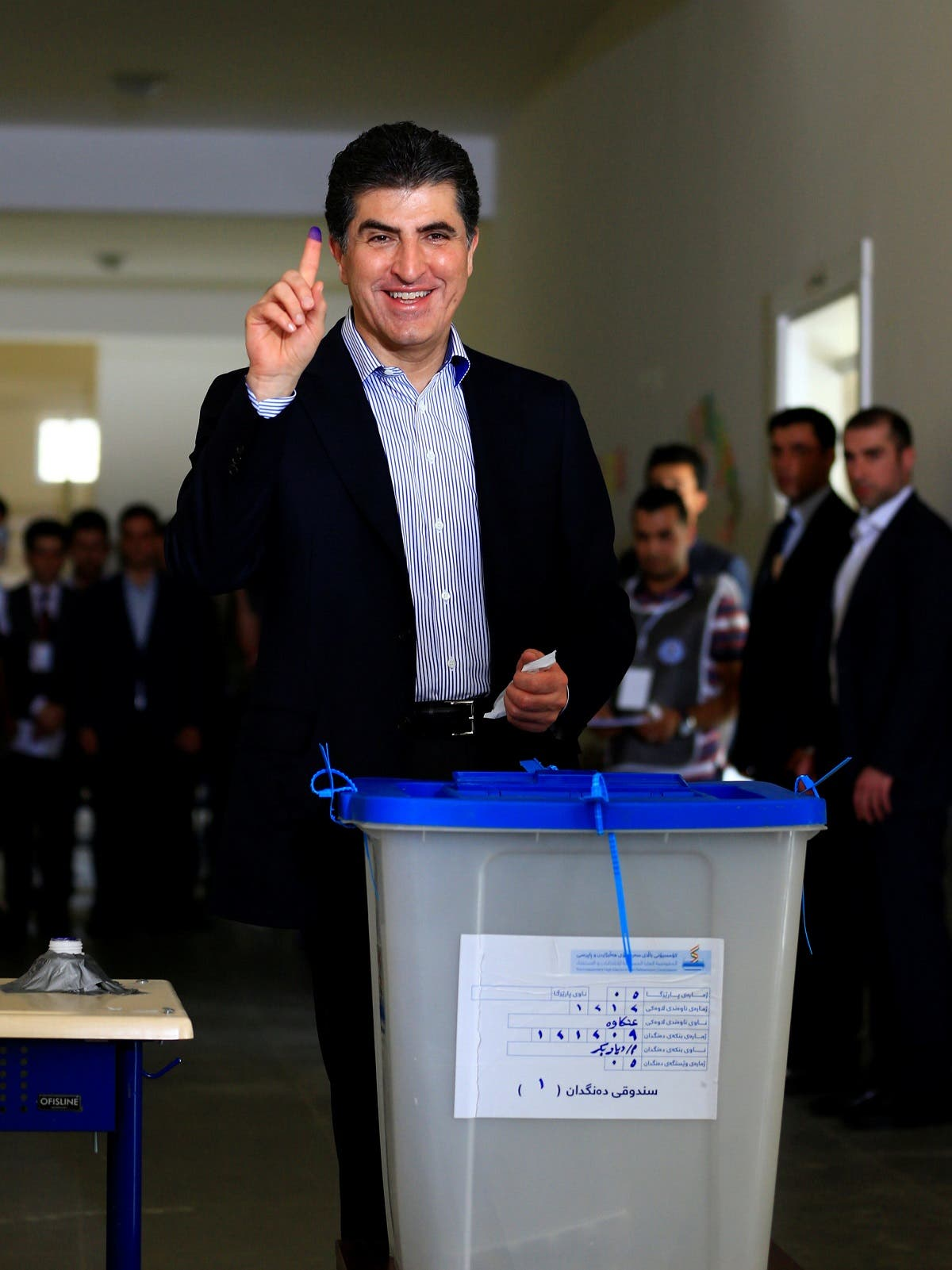 Kurdistan Regional Government Prime Minister Nechirvan Barzani casts his vote at a polling station during parliamentary elections in the semi-autonomous region in Erbil, Iraq September 30, 2018. (Reuters)