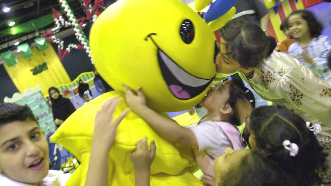 Children play with Modhesh, the cartoon character, in Dubai, on Aug. 24, 2001. (File photo: AP)