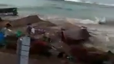WATCH: Indonesian man yells 'oh God' as tsunami wave crushes homes on beachfront