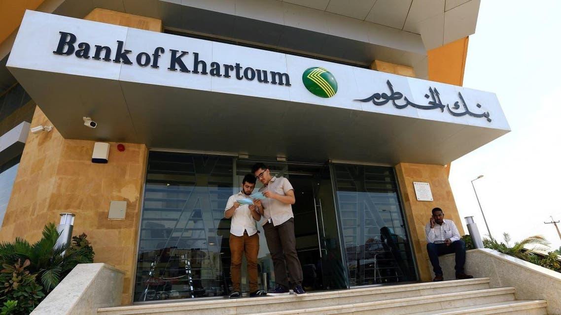 Customers wait outside the Bank of Khartoum. (Reuters)