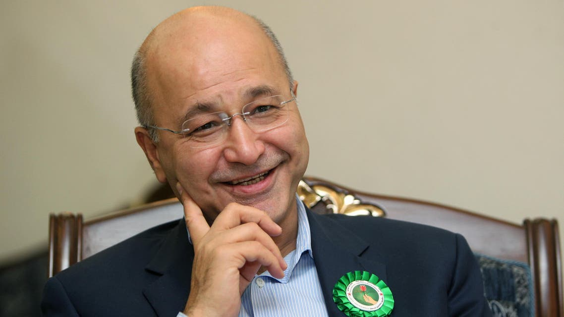 Barham Salih, a senior PUK politician who has held multiple top positions including prime minister of the Kurdish region, answers AFP journalists' questions during an interview on September 18, 2013 in Sulaimaniyah. As Iraqi President Jalal Talabani recovers in Germany from a stroke, his political party at home faces a stiff challenge from an emboldened opposition in upcoming Kurdish elections, with some forecasting a disastrous showing. AFP PHOTO/AHMAD AL-RUBAYE