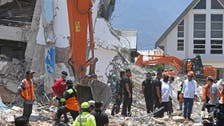 President visits as Indonesian quake survivors scavenging in 'zombie town'
