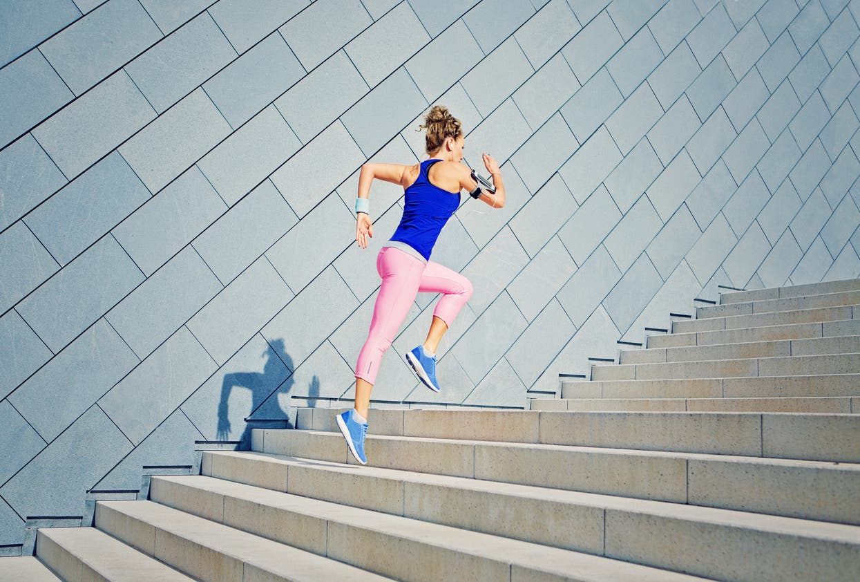 A woman running up a flight of stairs as part of her exercise routine. (File photo: Stock images)
