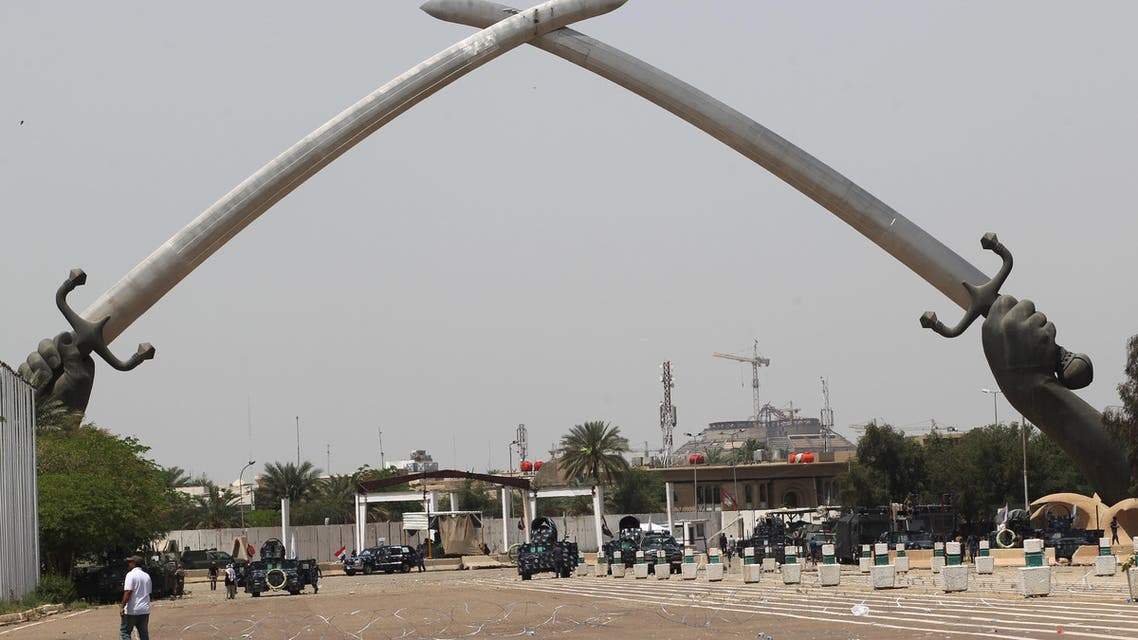 "Iraqis visit the ""Crossed Swords monument"" in Baghdad's heavily fortified ""Green Zone"" on May 1, 2016, the day after supporters of Shiite cleric Moqtada al-Sadr broke into the area after lawmakers again failed to approve new ministers."