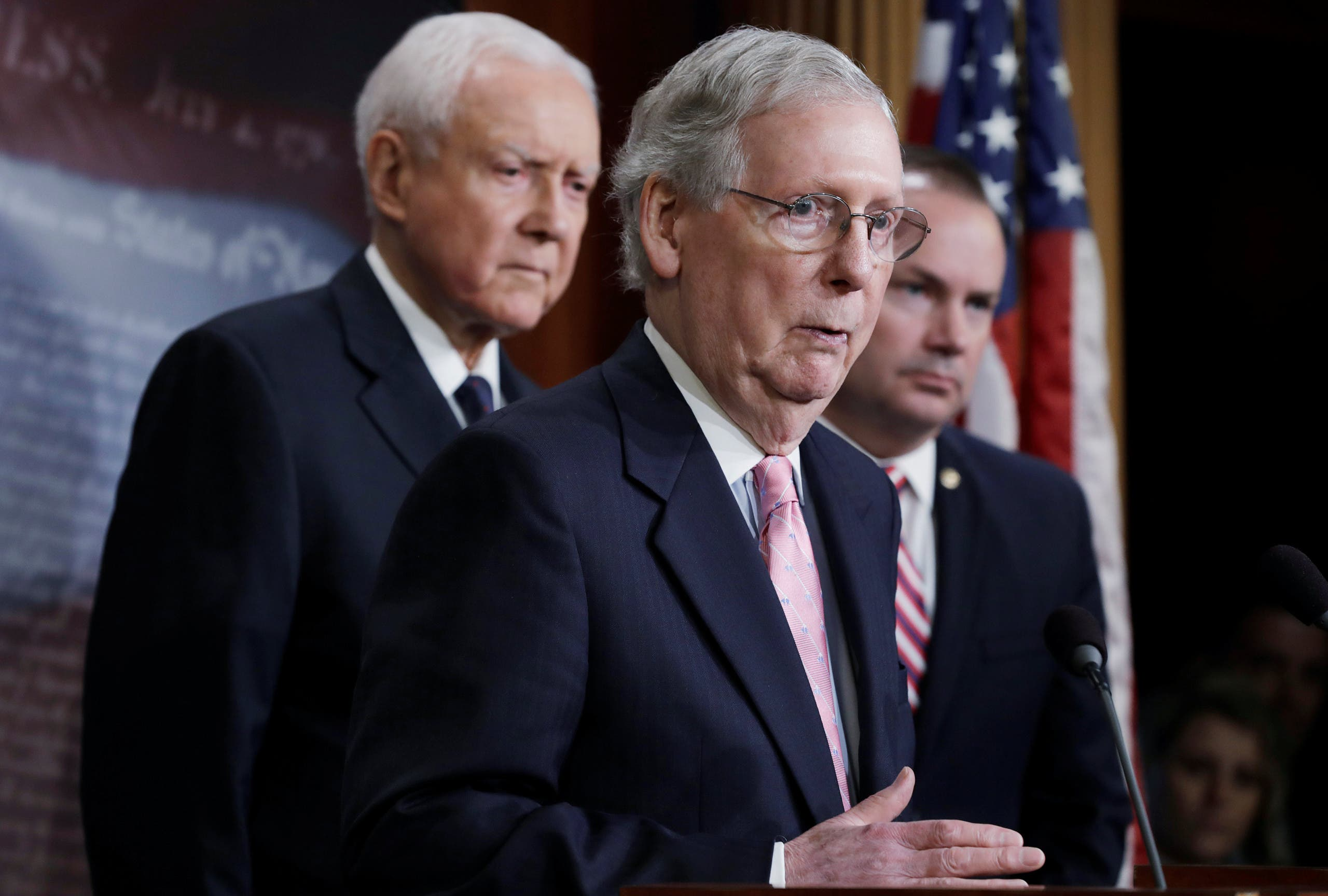 Senate Majority Leader Mitch McConnell holds a news conference with Senator Orrin Hatch (L) and Senator Mike Lee (R) to discuss the FBI background investigation into the assault allegations against Kavanaugh in Washington on October 4, 2018. (Reuters)