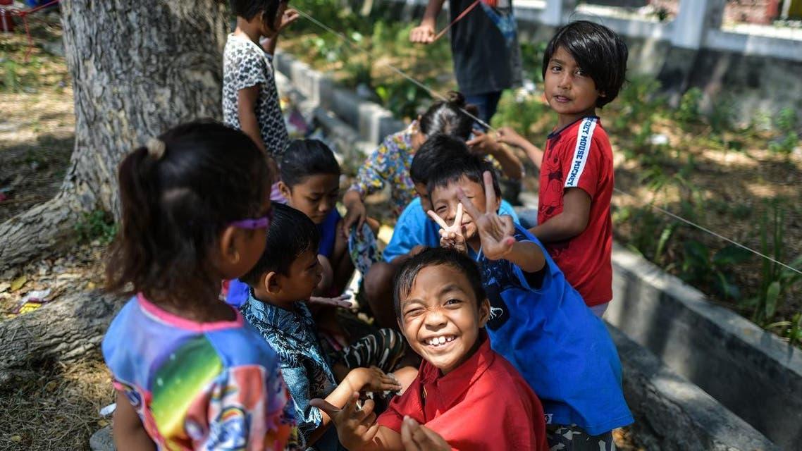 Indonesia children quake. (AFP)