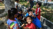 Storytellers give kids a laugh in Indonesia disaster zone