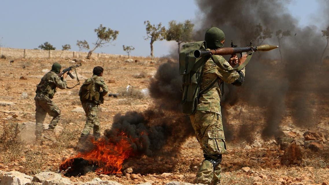 Syrian militant fighters take part in combat training at an unknown location in the northern countryside of the Idlib province. (AFP file photo)