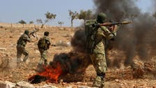 Syrian rebels start to withdraw heavy weapons from Idlib buffer zone