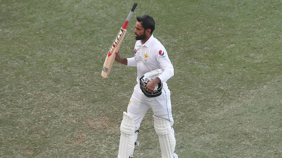 Mohammad Hafeez leaves the field on day one of the 1st test cricket match in Dubai on October 7, 2018. (AFP)