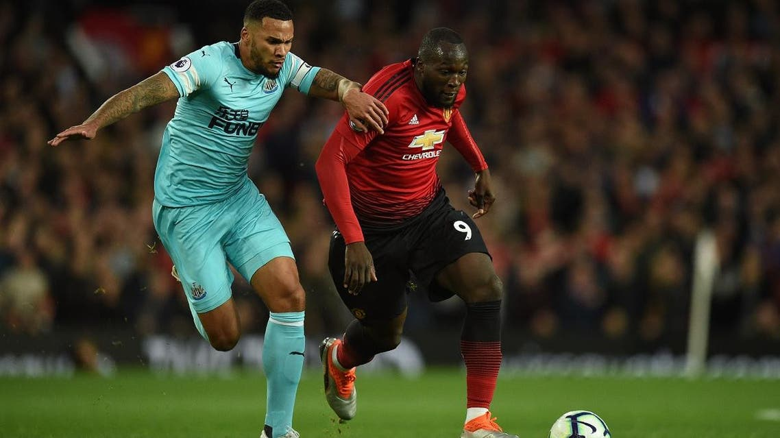 Newcastle United's English defender Jamaal Lascelles (L) vies with Manchester United's Belgian striker Romelu Lukaku during the English Premier League football match at Old Trafford in Manchester, north west England, on October 6, 2018. (AFP)