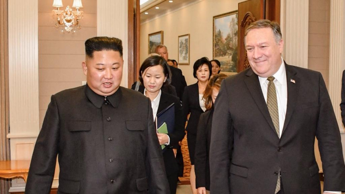 Pompeo and Kim Jong Un. (Twitter)