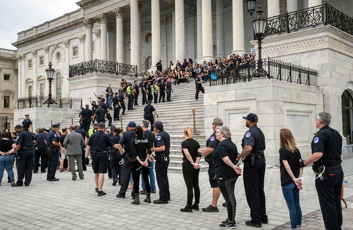 Crowds of activists are arrested after they rushed past barriers and protested from the steps of the Capitol before the confirmation vote on Supreme Court nominee, Brett Kavanaugh on Oct. 6, 2018. (AP)