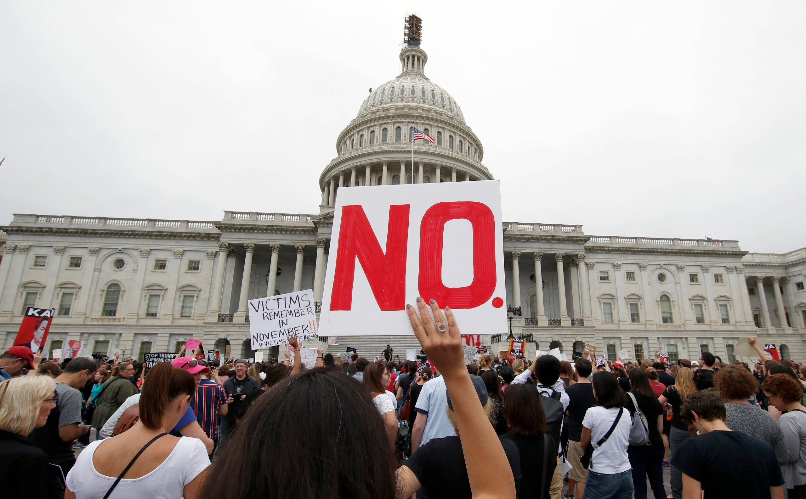 Activists demonstrate in the plaza of the East Front of the US Capitol to protest the confirmation vote of Supreme Court nominee Brett Kavanaugh on Oct. 6, 2018. (AP )