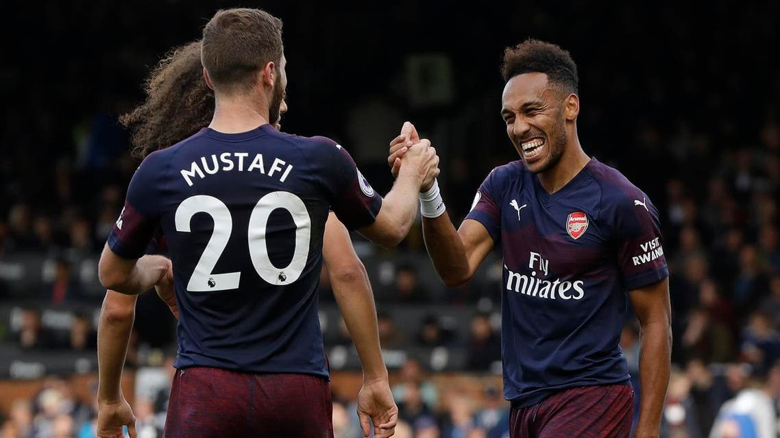 Arsenal's Aubameyang, right, celebrates after scoring his side's fifth goal against Fulham in London, on Oct. 7, 2018. (AP)