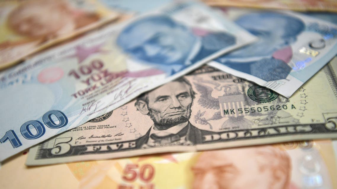 A picture taken in Istanbul on May 23, 2018 shows Turkish lira and US dollars banknotes. Turkey's embattled lira on May 23, 2018 hit new historic lows against the US dollar after suffering a hammering in Asian trade, as markets watched to see if the central bank takes emergency action to buttress the currency.
