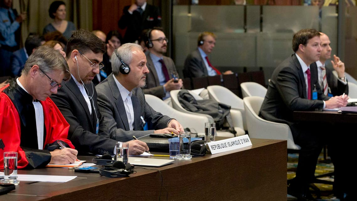 US and Iranian delegations listen to the ruling of the judges in The Hague on Oct. 3, 2018. (AP)