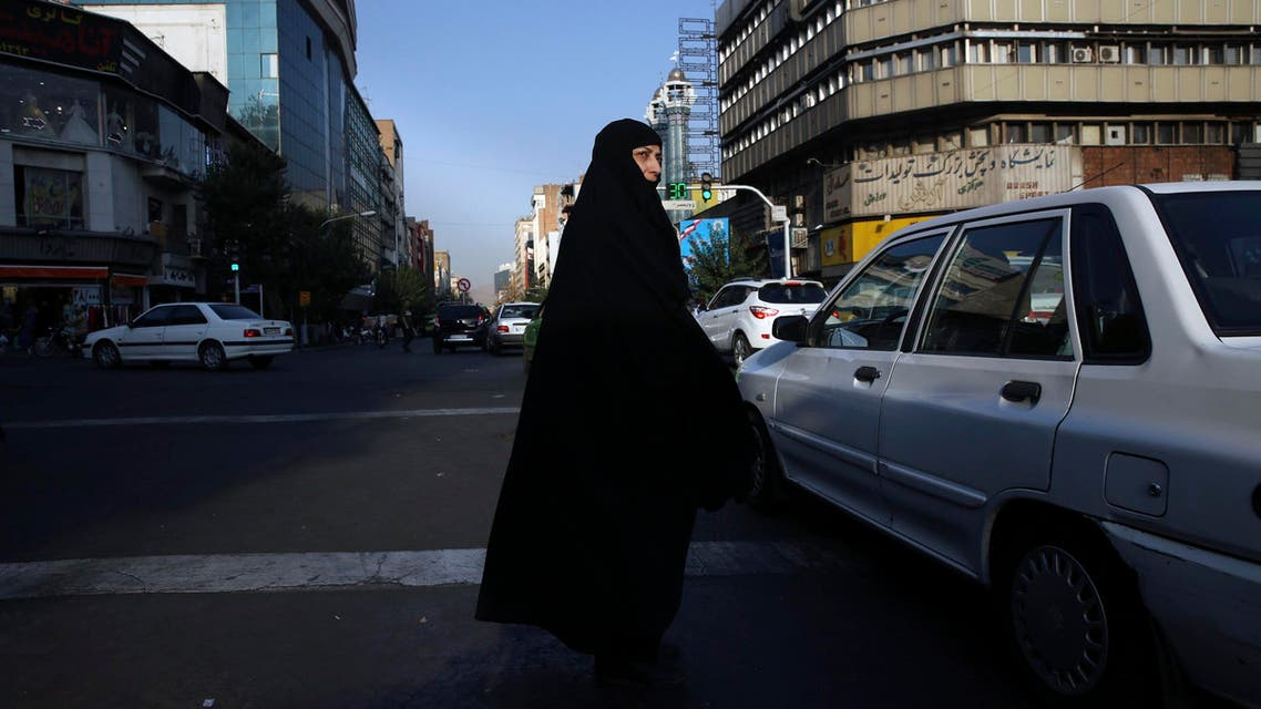 A veiled Iranian woman crosses Jomhouri-e-Eslami (Islamic Republic) St. in downtown Tehran on July 30, 2018. (AP)