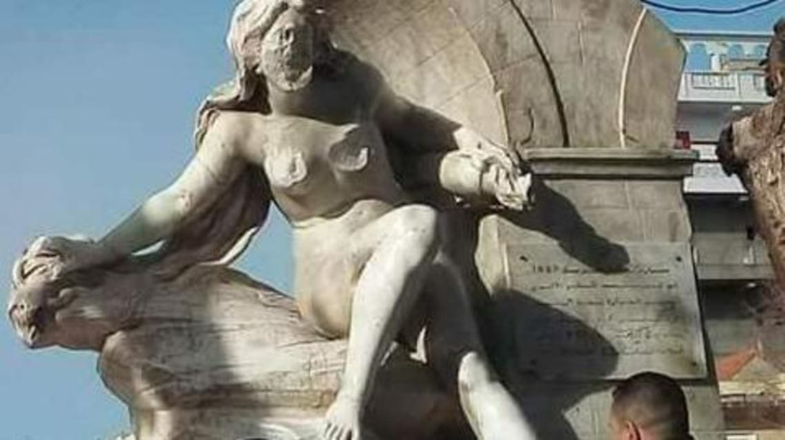WATCH: Man chisels away at face, chest of female statue in Algeria – again