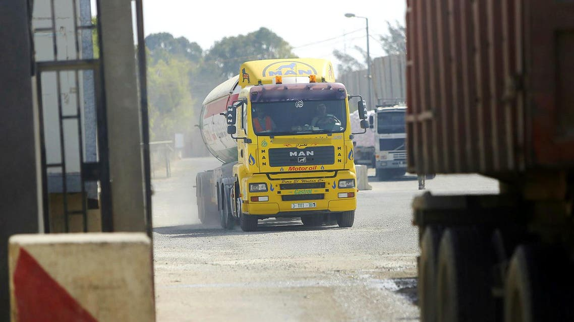 File photo for illustrative purposes: Trucks of fuel and good cross out of the Palestinian side of the Israeli Kerem Shalom cargo crossing into Gaza from Israel. (AP)