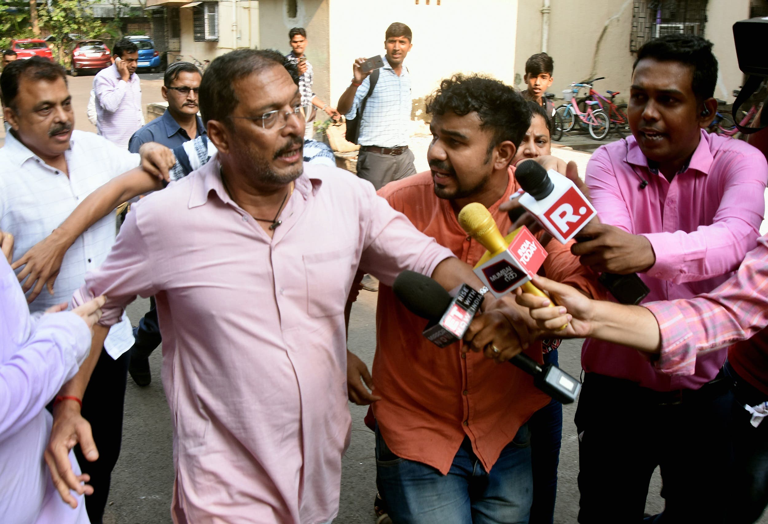 Bollywood actor Nana Patekar is mobbed by the media as he leaves after making a statement in Mumbai on October 8, 2018. (AFP)