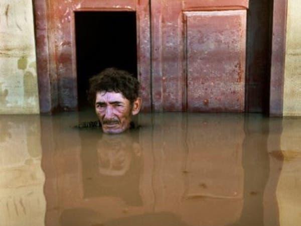 حكاية مصور مهووس بضحايا الفيضانات