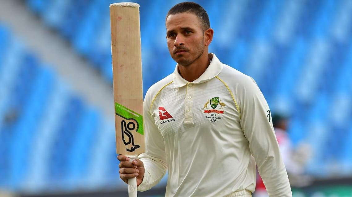 Australian cricketer Usman Khawaja leaves the pitch after being dismissed by Pakistan batsman Yasir Shah during day five of the first Test cricket match in Dubai on October 11, 2018. (AFP)