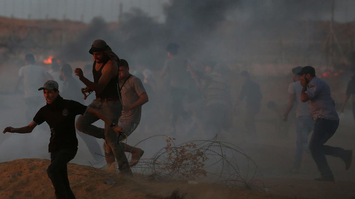 Palestinian demonstrators run during a protest calling for lifting the Israeli blockade on Gaza and demanding the right to return to their homeland, at the Israel-Gaza border fence in the southern Gaza Strip on October 12, 2018. (Reuters)