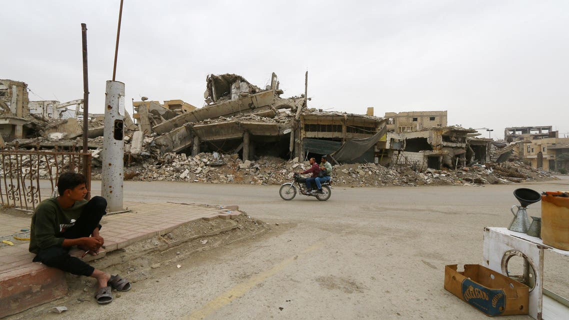 A man searches for belongings amid rubble of damaged buildings in Raqqa, Syria October 12, 2018. REUTERS/Aboud Hamam