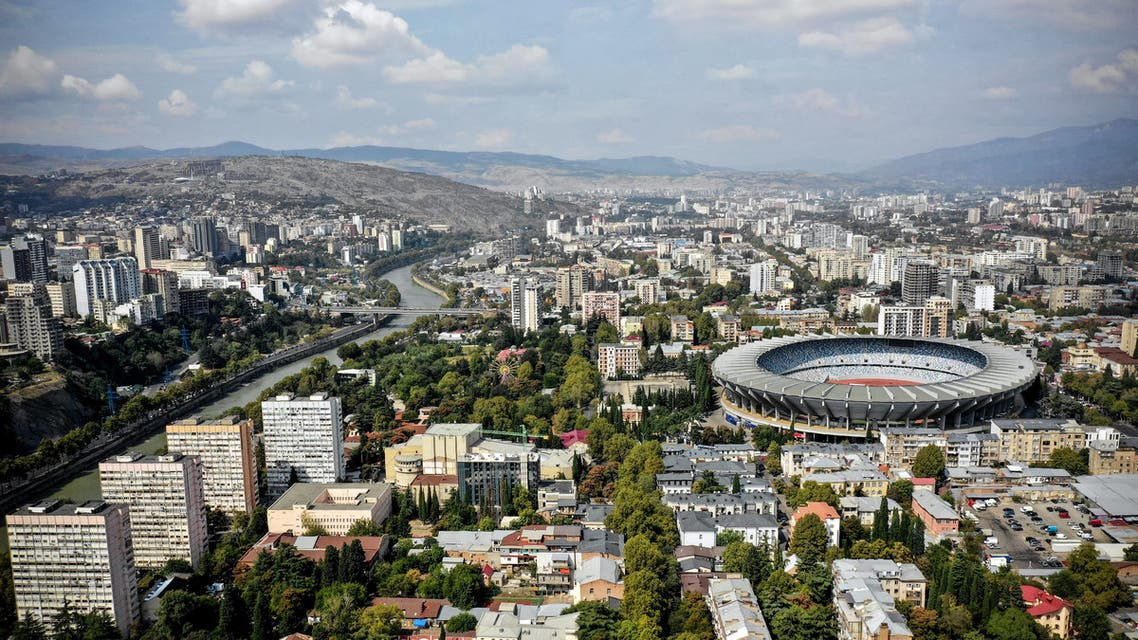 This aerial photograph taken on September 22, 2018, shows the view of The Boris Paichadze Dynamo Arena (R) in the centre of the Georgian capital Tbilisi.