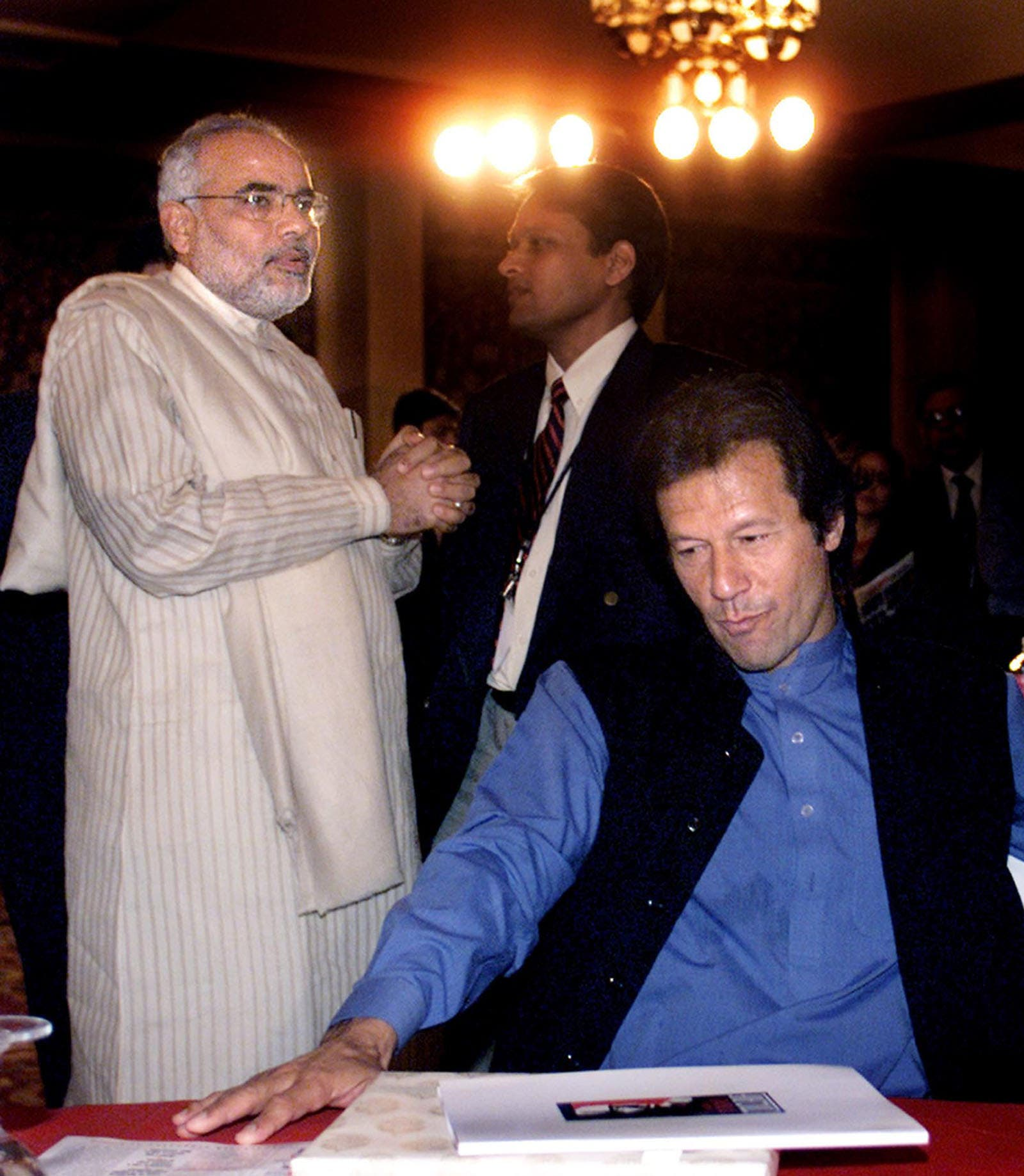 Then Gujarat Chief Minister Narendra Modi and Pakistani cricketer-turned politician Imran Khan in New Delhi on March 2, 2003. (File photo: AP)