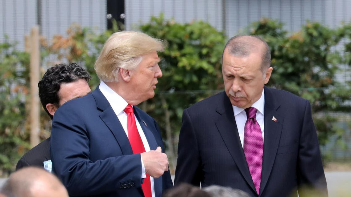 US President Donald Trump (L) speaks to Turkey's President Recep Tayyip Erdogan during the opening ceremony of the NATO (North Atlantic Treaty Organization) summit, at the NATO headquarters in Brussels, on July 11, 2018.