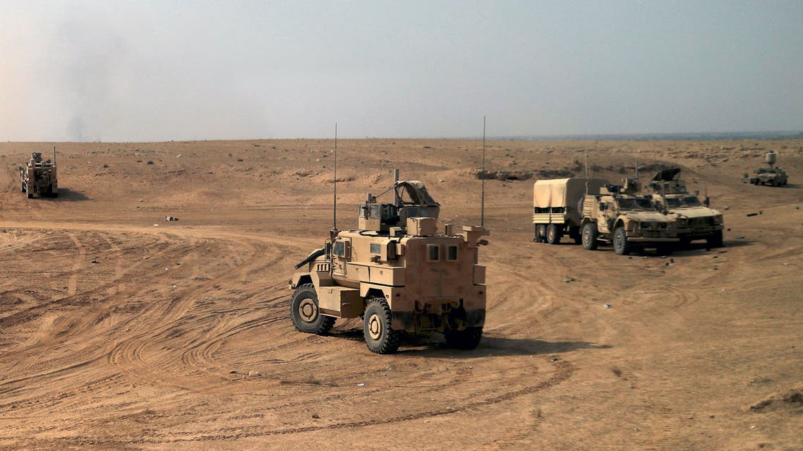 """US-backed forces are pictured near the village of Susah in the eastern province of Deir Ezzor, near the Syrian border with Iraq on September 13, 2018. US-backed fighters are fighting in Deir Ezzor to oust Islamic State jihadists from the town of Hajin on the east bank of the Euphrates, the most significant remnant of the sprawling """"caliphate"""" the jihadists once controlled spanning Syria and Iraq."""