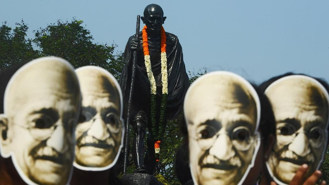 Indian students and volunteers wear masks of Mahatma Gandhi during a march to celebrate his 150th birth anniversary, in Kolkata on October 2, 2018. (AFP)