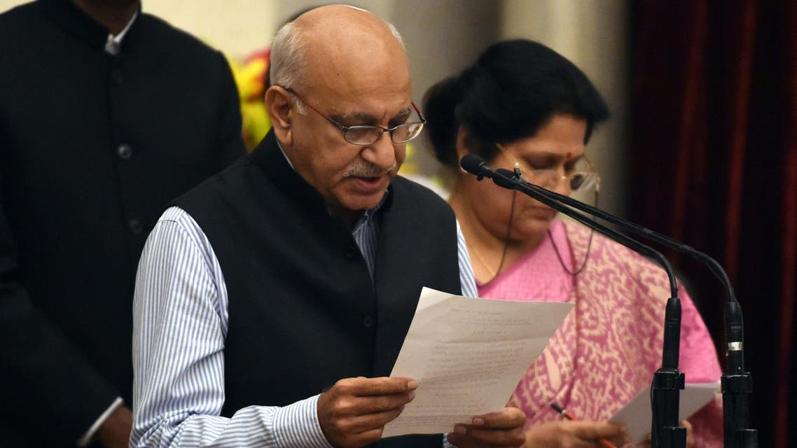 Bharatiya Janata Party politician, M. J. Akbar takes the oath during the swearing-in ceremony of new ministers following Prime Minister Narendra Modi's cabinet re-shuffle, at the Presidential Palace in New Delhi on July 5, 2016. (AFP)
