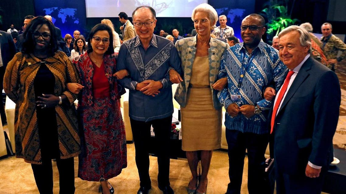 Central bank governors and finance ministers pose for photograpers before the Development Committee Meeting at International Monetary Fund - World Bank Group Annual Meeting 2018 in Nusa Dua, Bali. (Reuters)